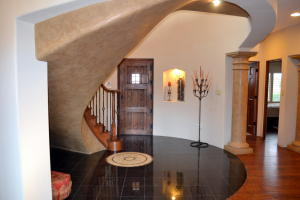 Striking Entry with Spiral Staircase