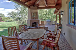 Covered back patio with fireplace