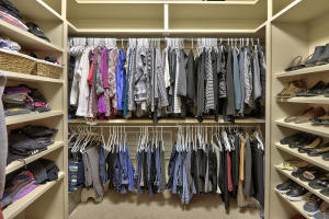 One of 2 master closets