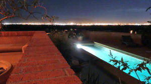 Pool and view from residence at night