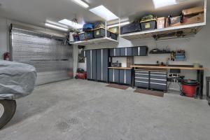Garage with 2 overhead metal doors