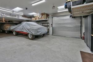 Garage addition with overhead doors