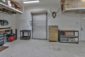 Smaller overhead door goes to backyard
