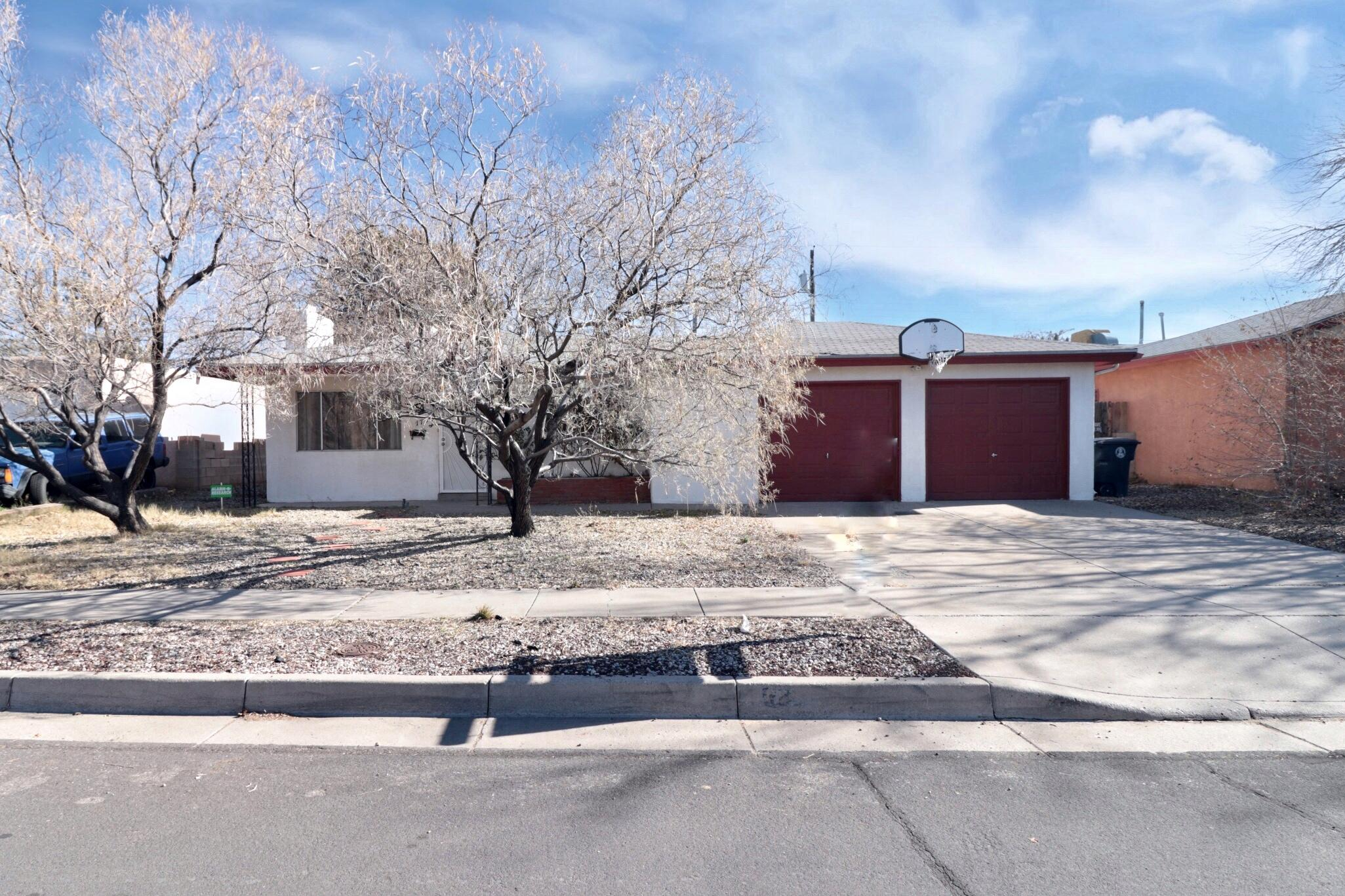 One of Albuquerque Northeast Heights 4 Bedroom Homes for Sale at 1736 NE Blume Street