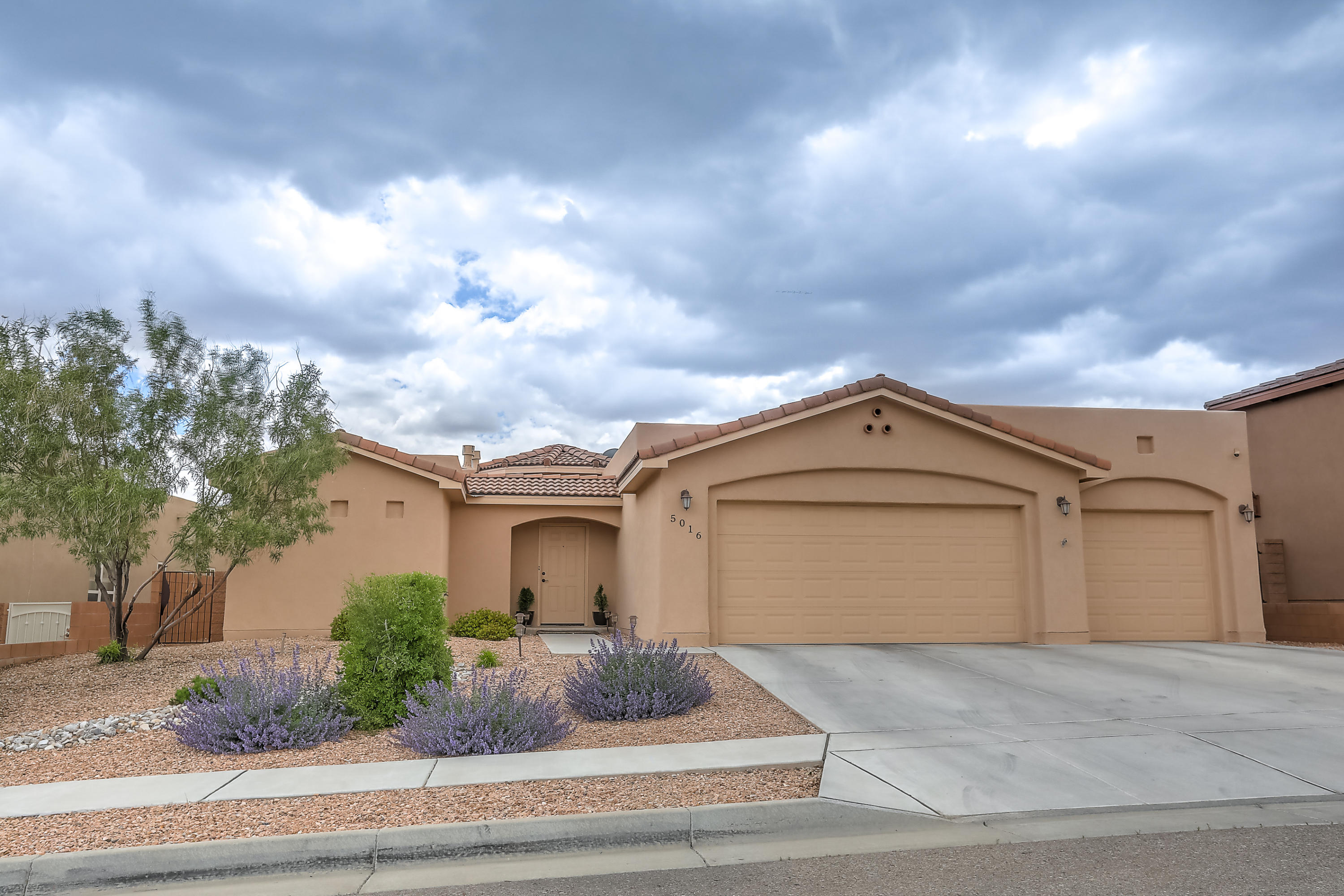 One of Northwest Albuquerque and Northwest Heights 4 Bedroom Homes for Sale at 5016 NW San Adan Avenue