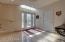 Travertine-tiled foyer