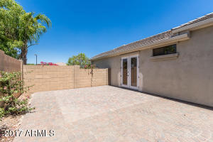 Wide paved patio leads to Flex room