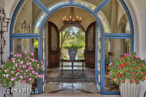 Entry Foyer With Arched French Door