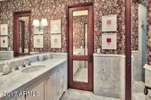 Auxillary Bathroom With White Marble