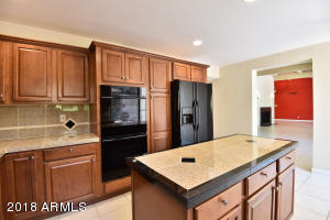 Kitchen island w/tiled counter tops.