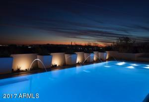 Pool with city light/sunset views
