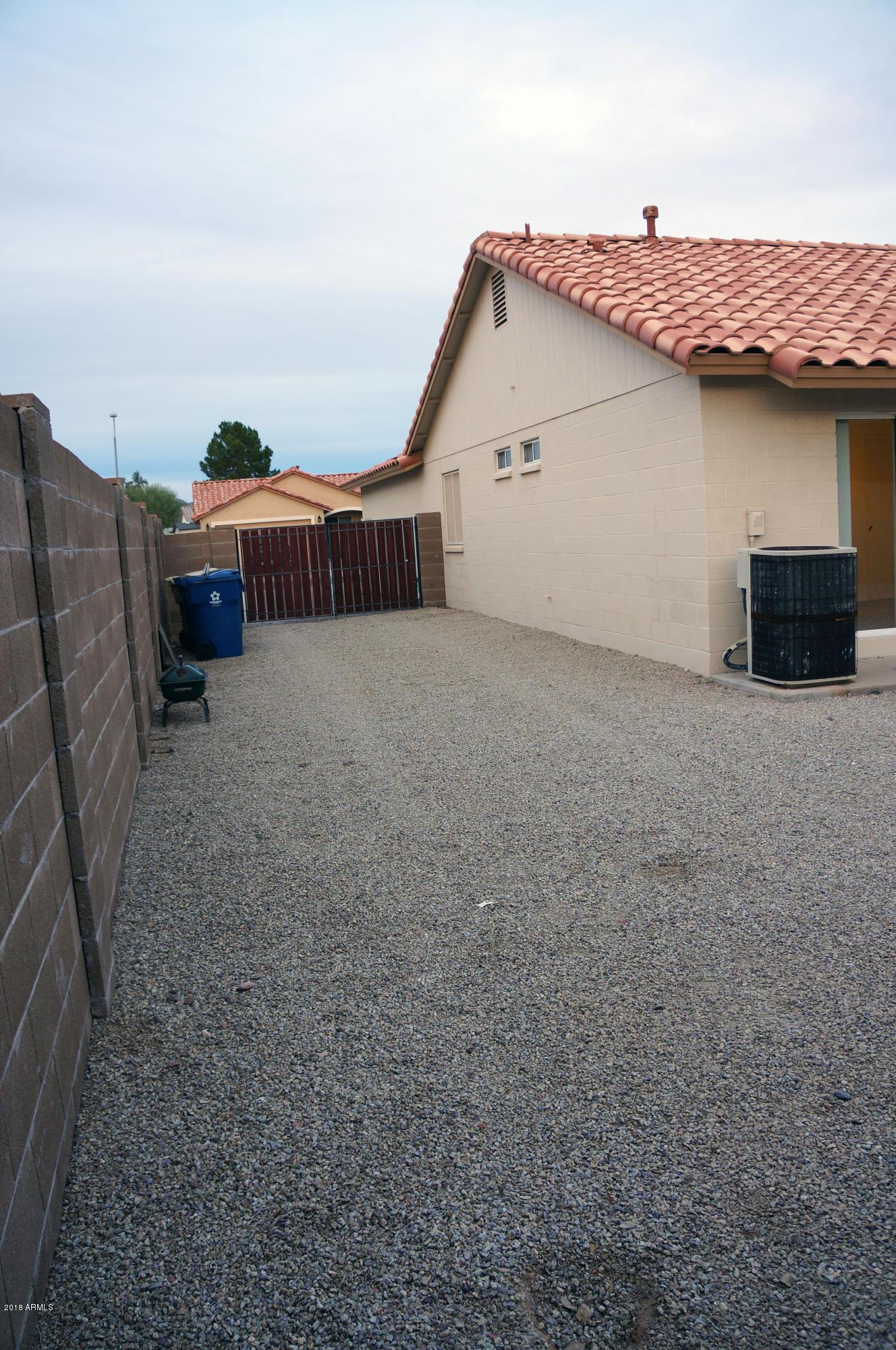 MLS 5857343 1379 W 14TH Avenue, Apache Junction, AZ Apache Junction AZ Golf Four Bedroom