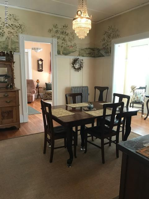 dining room with chandlier