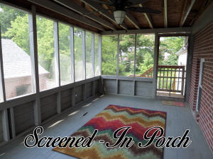 Property Photo: Screened in porch