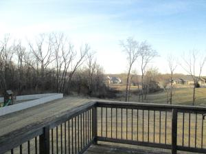 Property Photo: Deck Overlooking Yard