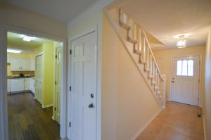 Property Photo: Entryway and Door to Basement