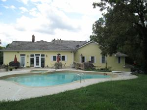 Property Photo: Entire Pool Looking Towards Back of Hiou