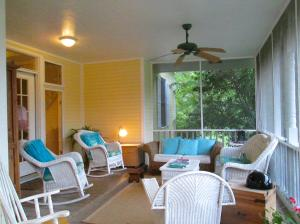 Property Photo: Screened Front Porch