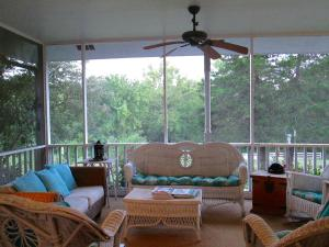 Property Photo: Screened Porch Looking Away from Front o