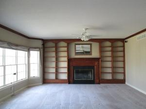 Property Photo: Family Room Bay Window & Fireplace