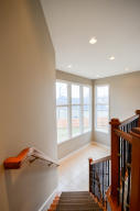 Property Photo: Stairway to Lower Level