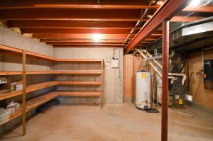 Property Photo: Unfinished Storage Room (2)