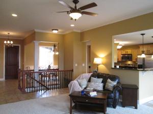 Property Photo: Living Room Looking to Front Door