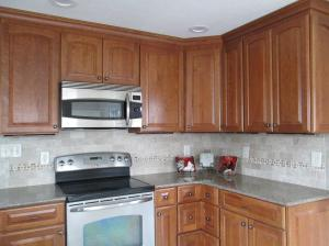 Property Photo: Beautiful Solid Cherry Cabinets