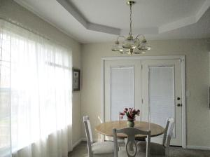 Property Photo: Dining Room with Deck Access