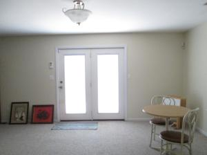 Property Photo: Family Room with Patio Access