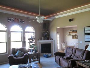 Property Photo: Living Room Corner Fireplace
