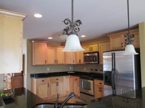 Property Photo: Kitchen from LR & Breakfast Bar