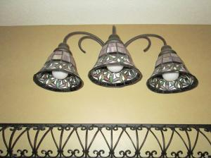 Property Photo: Lower Bath Light Fixture