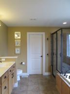 Property Photo: Master Bath Full View from Bedroom