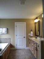 Property Photo: Master Bath Full View from Closet
