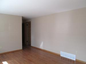 Property Photo: Living Room Refinished Wood Floors