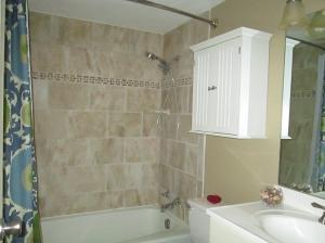 Property Photo: Hall Bath Tiled Tub Surround