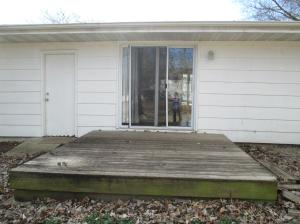 Property Photo: Deck Overlooks Fenced Yard