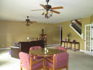 Property Photo: Family Room Open Stairway