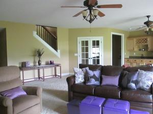 Property Photo: Family Room, French Doors & Open Stairwa