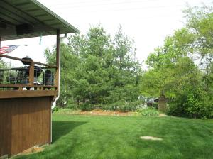 Property Photo: Covered Porch & Back Yard