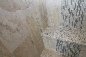 Property Photo: Custom tile and granite work in shower