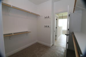 Property Photo: Master walk-in closet to bathroom