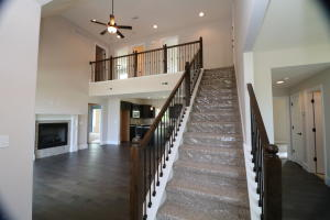Property Photo: View of staircase from entry