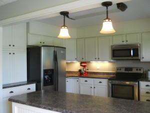 Property Photo: Kitchen Refrigerator & Pantry