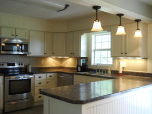 Property Photo: Kitchen with Bar