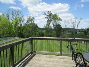 Property Photo: Spacious Deck Overlooking Yard