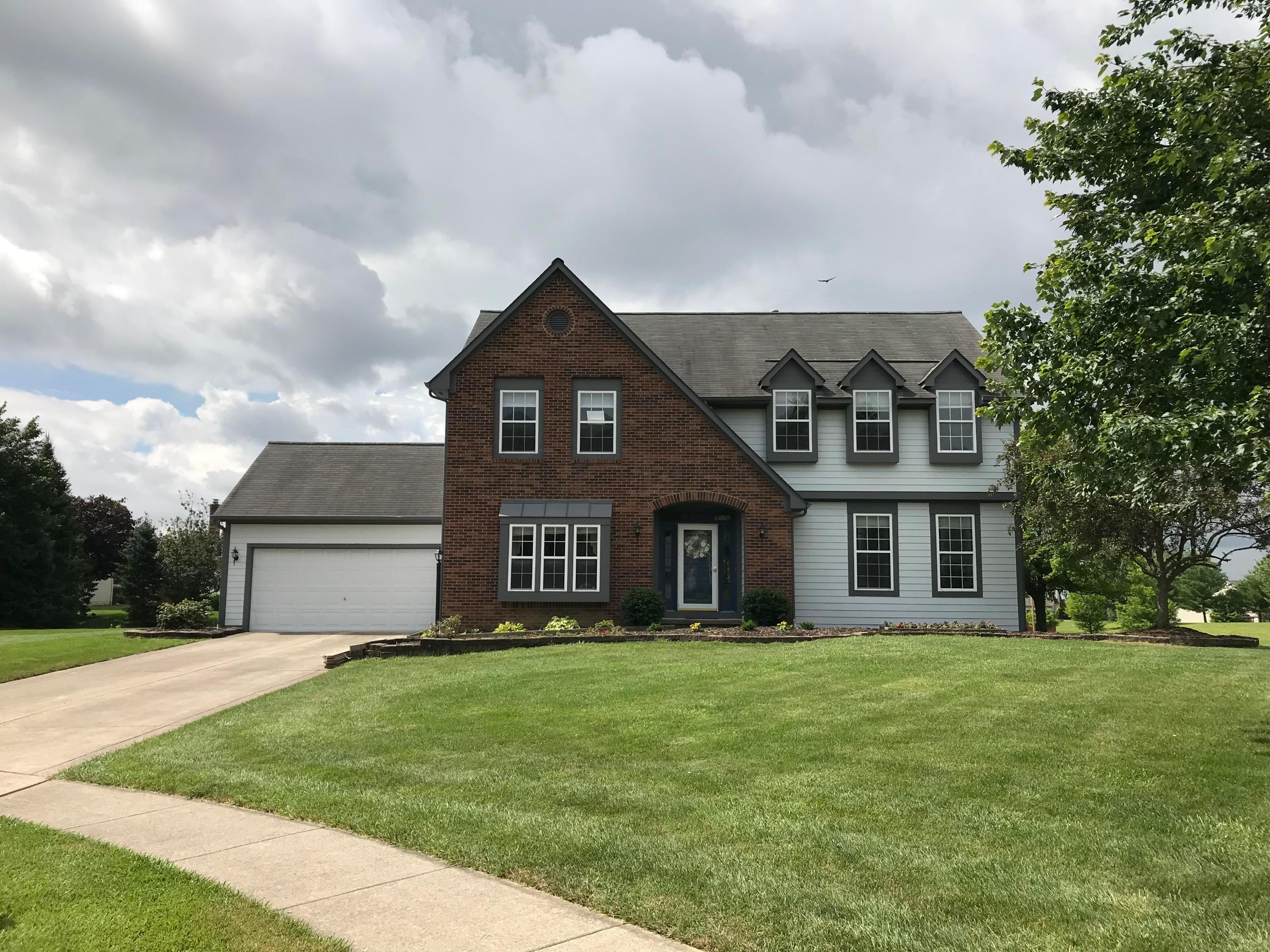 Photo of home for sale at 9305 Belmont Place NW, Pickerington OH