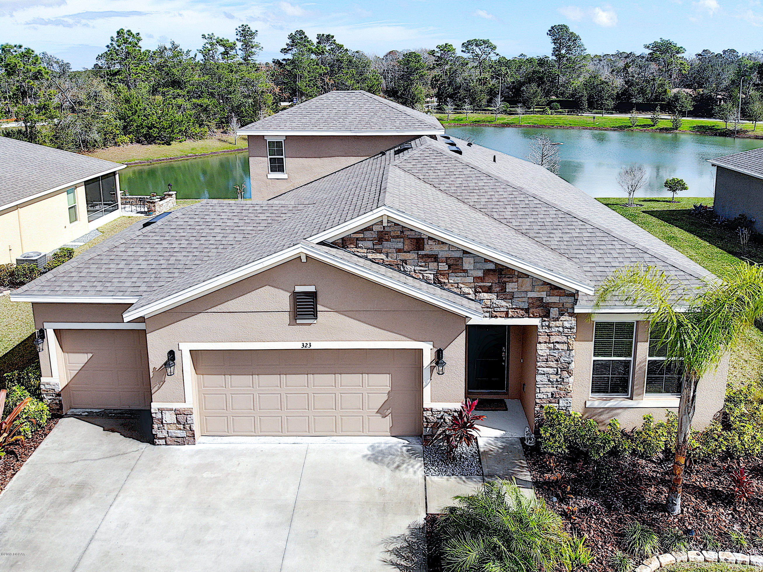 One of Ormond Beach 4 Bedroom Homes for Sale at 323  River Vale Lane