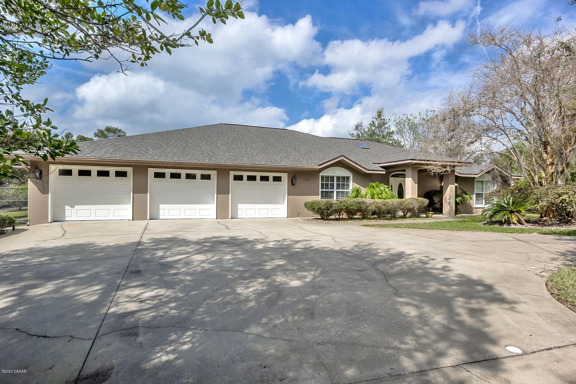 Photo of 5997 Seminole Woods Drive, Port Orange, FL 32127